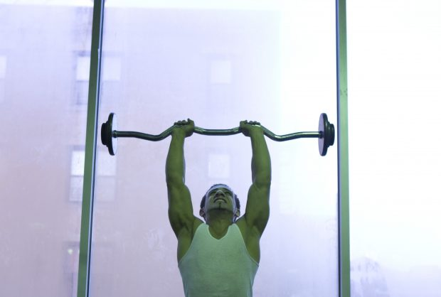 FILE — David Abusheik lifts weights at Dolphin Fitness in New York, Nov. 16, 2012. Within three hours of a bout of strenuous weight training, there are significant increases in markers of tissue breakdown. (Beatrice de Gea/The New York Times)