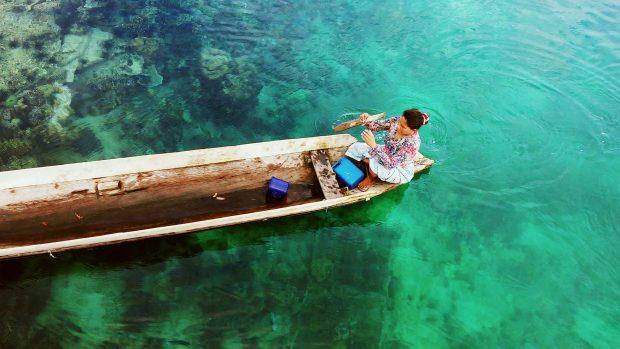 A local woman crosses the Sanga-Sanga channel.