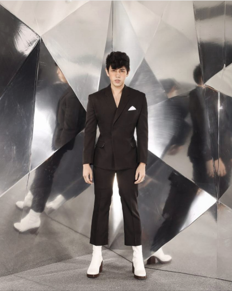 BJ Pascual in a dark brown notch-lapel suit and Balenciaga boots. Image from BJ Pascual's Instagram account.