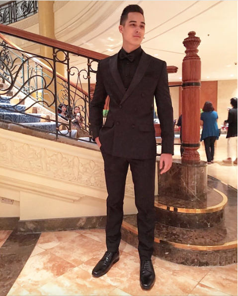 Tanner Mata opted for an all-black ensemble: a double-breasted coat and trousers by Bessie Besana. Image from stylist Adrianne Concepcion's Instagram account.